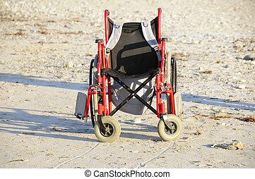 Wheelchair on the sand