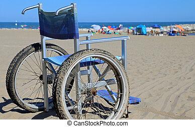 Wheelchair on the sandy beach