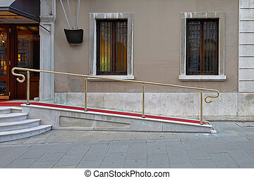Wheelchair ramp with red carpet for easy access in building