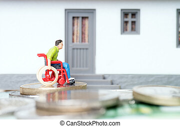 Wheelchair user in front of a house