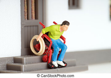 Wheelchair user on an exterior staircase