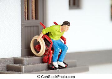 Wheelchair user on an exterior staircase