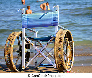 wheelchair with perforated wheels on the Sea Beach - Special...
