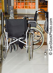 Wheelchairs in the store for sale. No body.