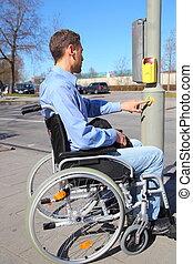 Wheelchairuser on a pedestrian crossing