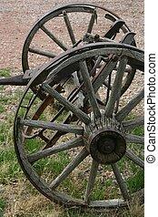 Wheels 3977 - Vintage wagon wheels bear silent witness to ...