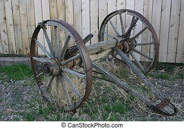 Wheels, Axel, And Tongue Are All That Are Left Of Old Wagon.