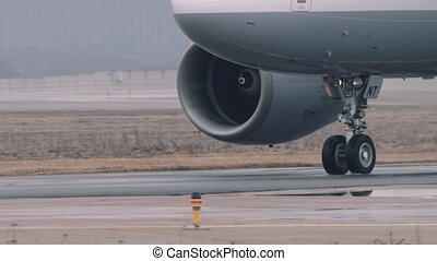 Wheels and turbines of an airbus a319-100 moving on a runway...