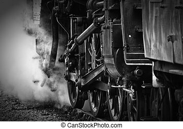 Wheels of a steam engine - Black and white image of the...