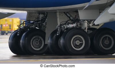 Wheels of aircraft undercarriage. Close up of taxiing...