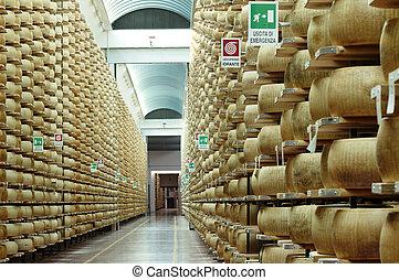 wheels of parmesan cheese in a stock seasoning