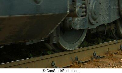 Wheels of the locomotive close up. Railway.