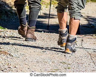 when hiking - feet with begrschuhen of people while hiking....