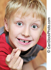where are you, tooth fairy - little boy showing his first...