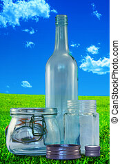 Three empty bottles without lids on on a vintage, grungy landscape background.