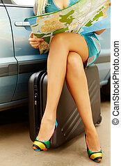 Where to go? - Photo of nice legs of elegant woman sitting...