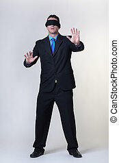 where to next - blind folded business man not knowing where ...