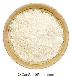 whey protein powder in a small ceramic bowl