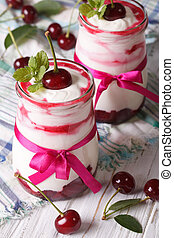 Whipped cream with fresh cherries close up. vertical