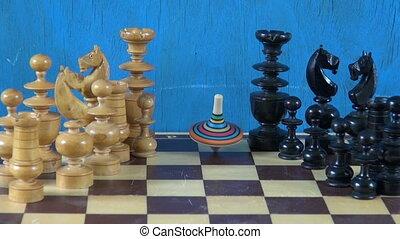 Whirligig on chess board - Colorful whirligig turning on...