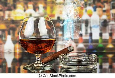 Whiskey and cigar - The whiskey and smoking cigar in bar