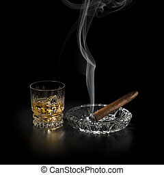 Whiskey and cigar - Whiskey and smoking cigar on black...