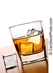 Whiskey and Ice - Glass of Whiskey with ice cube
