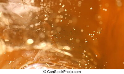 whiskey and ice in glass, bubble float, background