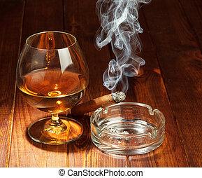 Whiskey and smoking cigar