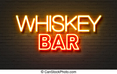 Whiskey bar neon sign on brick wall background.