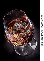 Whiskey / Cognac on black background - photo of whiskey...