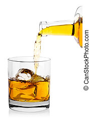 Whiskey from bottle poured into glass with ice cubes