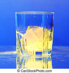 Whiskey glass with burning ice on dusty table