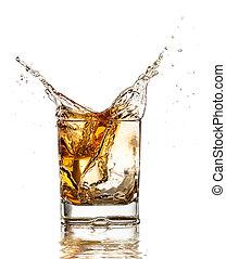 Whiskey glass with splash, isolated on white background