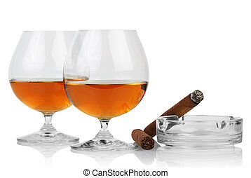 Whiskey in glasses and cigar
