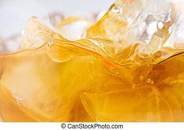 Whiskey on ice close-up stock photo