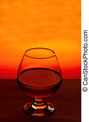 Whiskey or brandy on a wooden table