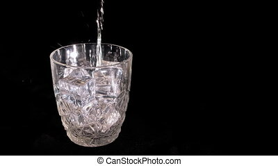 Whiskey poured into a glass bacgraund.