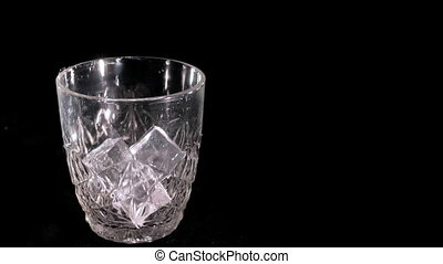 Whiskey poured into a glass slow motion
