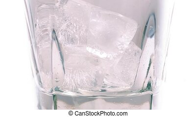 Whiskey Poured Over Ice Closeup - Whiskey on the rocks on...