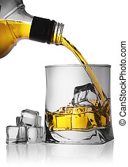 Whiskey pouring from the bottle into a glass with ice