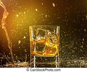 Whiskey splashing around glass