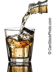 Whiskey being poured into a glass on white background