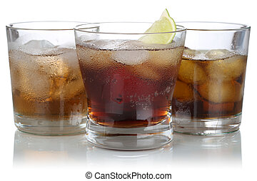 Whisky, alcohol and cola with ice cubes