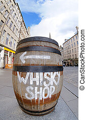 Whisky barrel sign - A sign on a whisky barrel points the ...