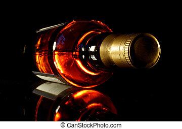 Whisky - Bottle of whisky with black crisp background