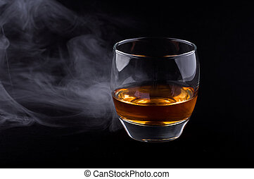 Whisky glass - Photo of whisky glass in a smoke against ...