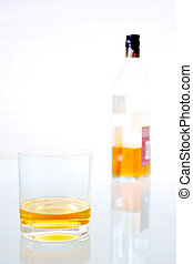 whisky glass with bottle