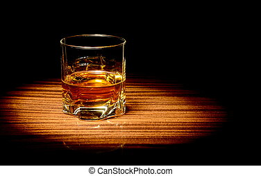 Whisky in a glass - Studio shot of whisky in a glass lit...