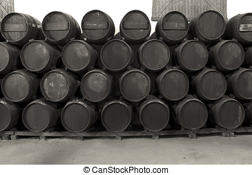 Whisky or wine barrels in black and white